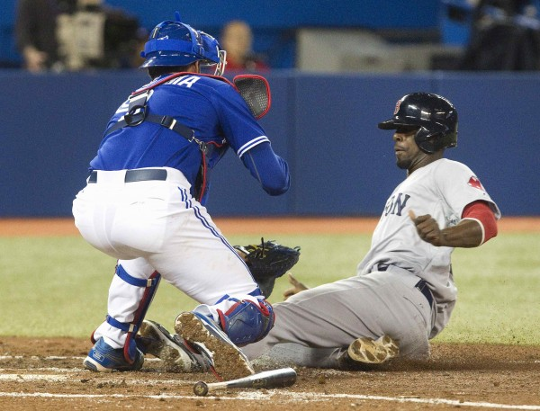 Boston Red Sox's Pedro Ciriaco (right) is out at home plate as Toronto Blue Jays' catcher J.P. Arencibia blocks home plate with the tag during the third inning of their MLB American League baseball game in Toronto on Saturday.