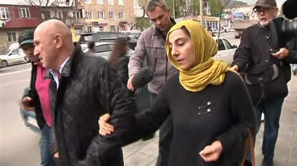 Journalists chase Zubeidat Tsarnaeva (R, front), mother of Boston bombing suspects Dzhokhar and Tamerlan Tsarnaev, in Makhachkala in this image from an April 23, 2013 video footage.