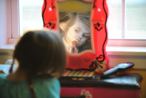 Maggie Rudnicki applies makeup at her vanity in her parents' living room in Levant on Friday. Maggie has Diamond-Blackfan anemia, a disorder that prevents her body from generating red blood cells. Her brother Lucas will be a bone marrow donor this summer in order to help his little sister.