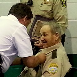 Washington County Sheriff Donnie Smith pins an award marking his retirement on Lester Seeley, who died over the weekend.