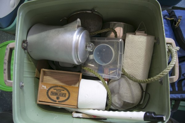 A box containing cookware and toiletries taken from Christpher Knights campsite in Rome near North Pond.