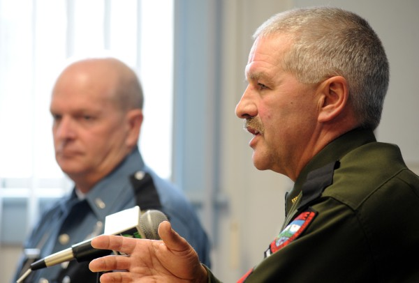 Sgt. Ron Dunham (right) of the Maine Warden Service and Lt. Wesley Hussey of the Maine State Police discuss the dangers of Chicken Fest during a press conference on Thursday at the Orono Police Department.
