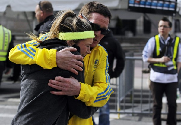 A woman is comforted by a man near a triage tent set up for the Boston Marathon after explosions went off at the 117th Boston Marathon in Boston, Mass., on Monday.
