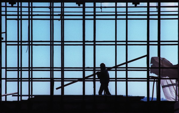 A construction worker moves along the upper floor of what would become a glassed-in walkway in the outpatient surgery center then under construction at Eastern Maine Medical Center in Bangor.
