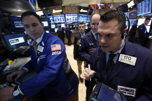 Traders work on the floor at the New York Stock Exchange, April 1, 2013.