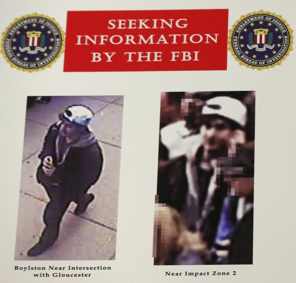 Photos of a suspect in the Boston Marathon bombings are seen during a news conference in Boston, Mass., April 18, 2013.