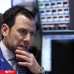 Wall Street slides in volatile week, eyes on the Fed