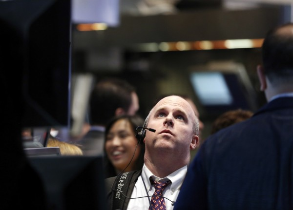 Traders work on the floor at the New York Stock Exchange, April 30, 2013.