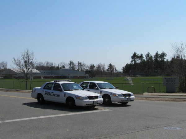 Police cars block the driveway at Gorham Middle School Friday just after 3 p.m. An officer on duty said investigators are responding to a bomb scare at the location, and no students remained in the building at that time.