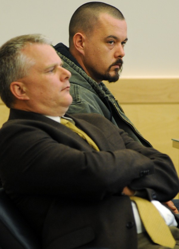 Scott Peavey (right) was sentenced at the Penobscot Judicial Center on Tuesday to four years in prison with all but 18 months suspended and two years of probation for the assault on a child under the age of six, which is a felony. Peavey sits with his attorney Stephen Smith.
