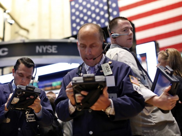 Traders work on the floor at the New York Stock Exchange, April 29, 2013.