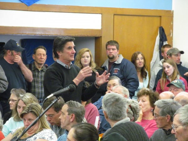 Baldwin resident Larry Lord discusses at Saturday's special town meeting why he proposed reducing the pay town selectmen receive. Lord told fellow residents the proposal wasn't intended to be taken personally.