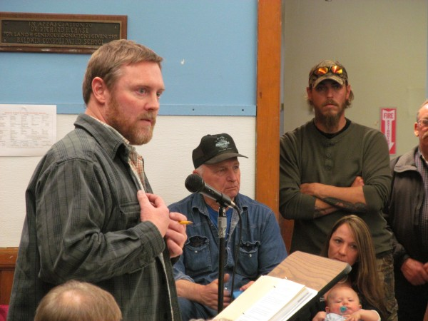 David Strock, moderator for Saturday's special Baldwin town meeting, goes over the ground rules for the meeting.