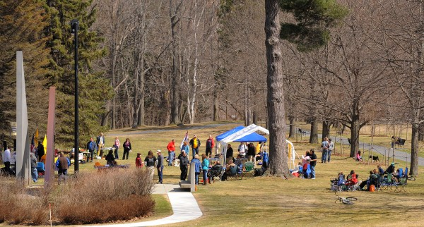 About 60 people attended a Patriots Day rally at Capitol Park in Augusta on Monday.