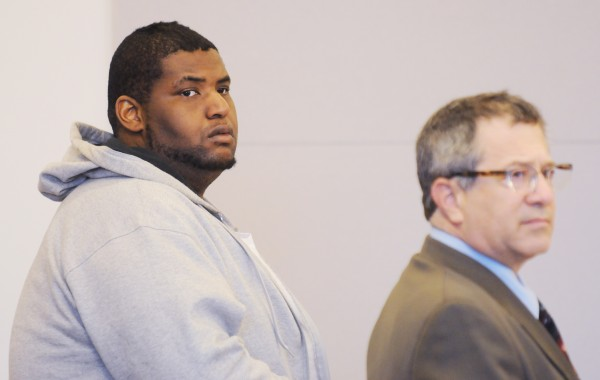 Akeem Harris (left) stands with his attorney Jeffrey Silverstein during his arraignment at the Penobscot Judicial Center in Bangor on Friday. Harris is currently being held without bail on charges related to the April 9, 2013, stabbing death of Thomas N. Taylor of Bangor.