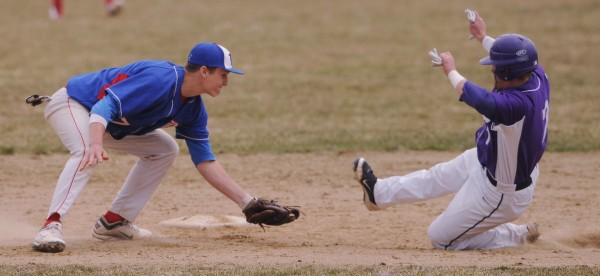 Messalonskee's Jake Dexter looks to tag Hampden's Logan Stewart as he slides into second on a steal during  second inning action against Mesalonskee. Stewart was called safe.