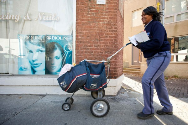 United States Postal Service Letter Carrier Lakesha Dortch-Hardy delivers mail in Chicago in this file photo taken November 29, 2012.