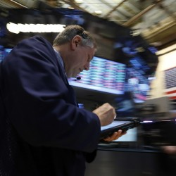 Wall Street gains on Bernanke comments, S&P above 1,500