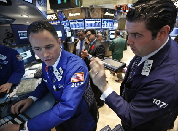 Traders work on the floor at the New York Stock Exchange, April 17, 2013.
