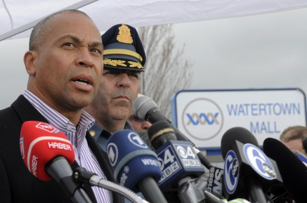 Massachusetts Gov. Deval Patrick speaks during a news conference as Massachusetts State Police Col. Timothy Alben watches in Watertown, Mass., on Friday evening. Shortly after Gov. Patrick announced a shelter-in-place order had  been lifted, more shots were fired in Watertown and the order was reinstated for the surrounding area.