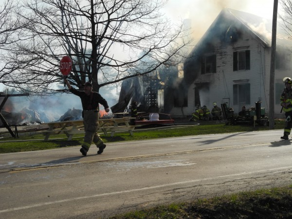 A firefighter works at the scene of a fire on Route 137 on Monday afternoon that destroyed the home of Jackie and Bill Bryant. The house, built in the 1800s, used to be a stagecoach stop on the Waterville-Belfast route, Jackie Bryant said.