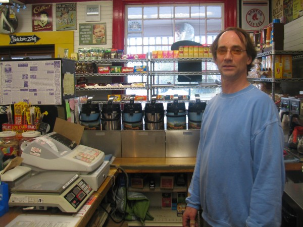 Richard Simis, owner of the Town Hill Market in Bar Harbor, stands behind the counter Wednesday in the same spot he was standing earlier that morning when a masked robber wielding a gun came into the store a few minutes before it was expected to open at 6 a.m.