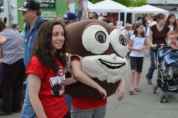 A volunteer helps Sweetie Pie, the mascot for the fourth annual Maine Whoopie Pie Festival, around to meet children in Dover-Foxcroft on Saturday, June 23, 2012.