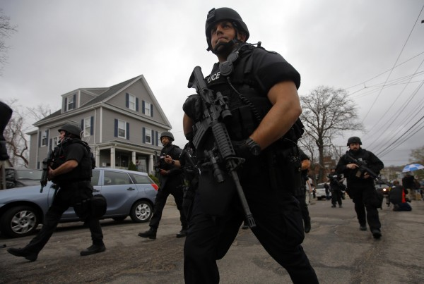 Police officers search house to house for the second suspect in the Boston Marathon bombings in a neighborhood of Watertown, Massachusetts April 19, 2013.