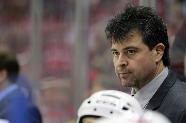 New York Islanders head coach Jack Capuano watches from the bench against the Washington Capitals during a game on March 26 in Washington. Capuano, a former University of Maine hockey standout, has led the Islanders to a playoff berth.