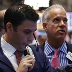 Wall Street slides as Fed minutes spark concern