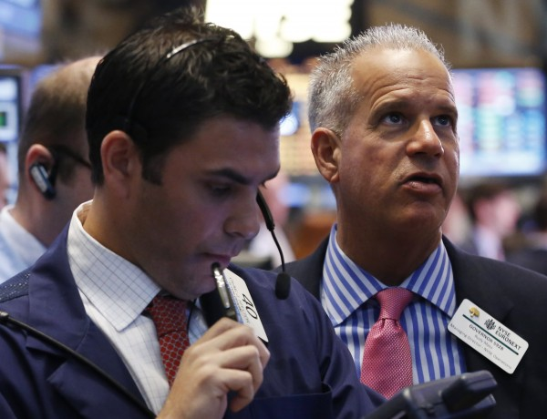 Traders work on the floor at the New York Stock Exchange on April 15, 2013.