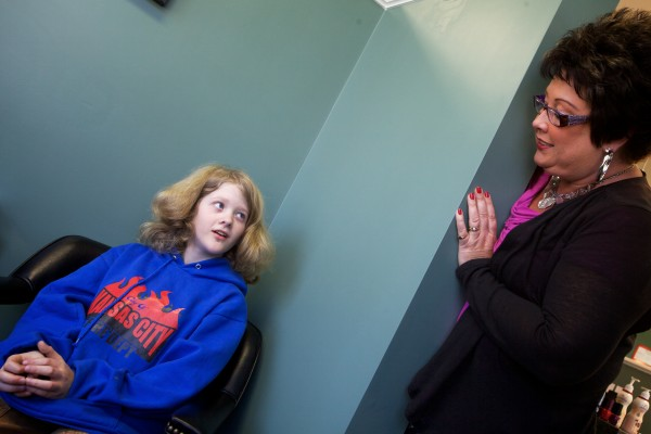 Josh Demers, 12,  gets the word from Amy Fabus at  Texture Hair Designs in Bath that it's his turn Friday afternoon. Demers grew his hair for two years so he could donate it to Lock of Love, an organization that makes wigs for cancer patients.