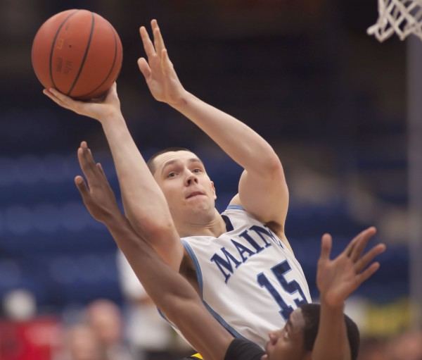 UMaine basketball player Alasdair Fraser puts up a shot against UMBC in Orono in January.