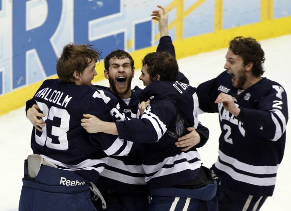 Yale's Jeff Malcolm (L-R), Charles Orzetti, Rob O'Gara and Gus Young celebrate their win over Quinnipiac to earn the men's NCAA college ice hockey national championship game in Pittsburgh, Pennsylvania, April 13, 2013.