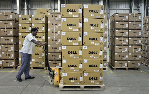 A man pushes a trolley full of Dell computers through a company factory in Sriperumbudur Taluk, in the southern Indian state of Tamil Nadu, in this June 2, 2011, file photograph. Personal computer sales plunged 14 percent in the first three months of 2013, the biggest decline in two decades of keeping records, as tablets continue to gain in popularity and buyers appear to be avoiding Microsoft Corp.'s new Windows 8 system, according to a leading tech tracking firm.