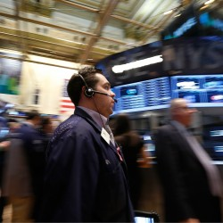 Wall Street closes higher, Alcoa volatile after results