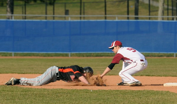 Bangor's Jordan Derrah (right) picks off Skowhegan's Adam Clukey at second base during the game in Bangor on Monday.