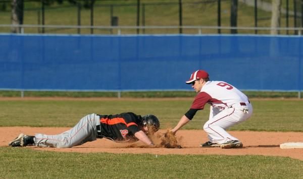 Bangor's Jordan Derrah (right) picks off Skowhegan's Adam Clukey at second base during the game in Bangor on Monday.