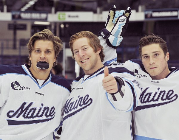 Maine hockey players (from left) Theo Andersson, Mark Anthoine and Jon Savely have fun with a BDN photographer  during the team's annual media day in 2011.