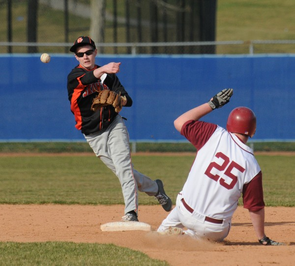 Skowhegan's Kameron Nelson (left) throws the ball to first base after forcing out Bangor's Brendan Moore during the game in Bangor on Monday.
