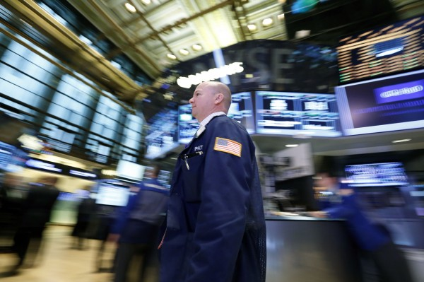 A trader works on the floor at the New York Stock Exchange, April 23, 2013.