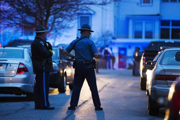 Law enforcement officials stand at the scene on Franklin Street, as the search for Dzhokhar Tsarnaev, the surviving suspect in the Boston Marathon bombings, comes to an end in Watertown, Mass., on Friday.