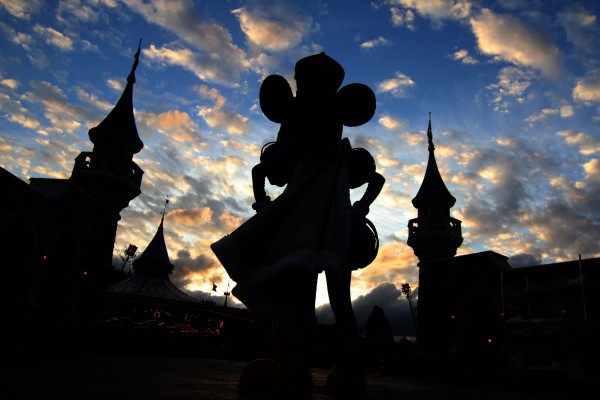 Mickey Mouse watches the sun set at the New Fantasyland at Walt Disney World's Magic Kingdom in Lake Buena Vista, Fla., in this Dec. 5, 2012, file photo.
