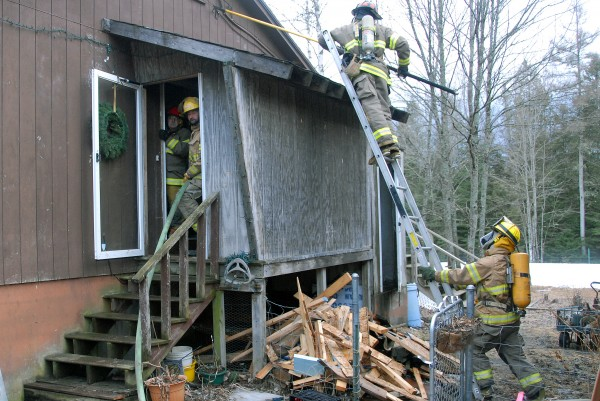 Firefighters from Howland, Lincoln and Mattawamkeag had to dig into a home at 345 Transalpine Road in Lincoln on Monday, April 1, 2013.