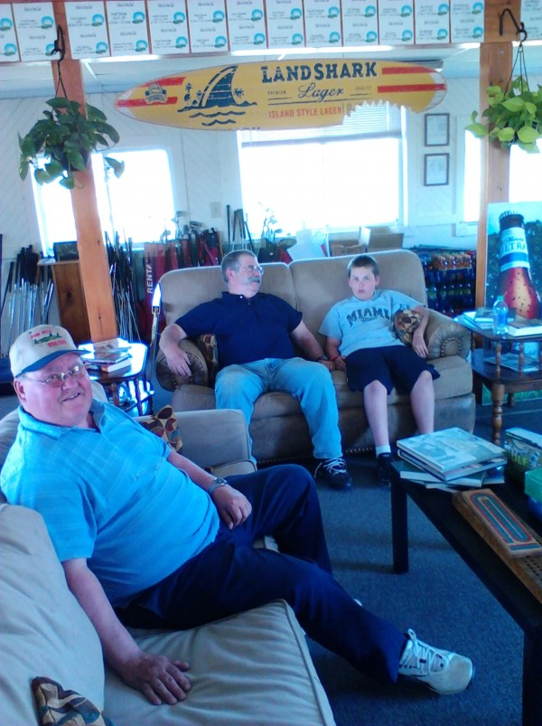 Larry Brooks (left), Mike LaChance (center) and Kolby Brooks relax on the new couches at Pine Hill Golf Club in Brewer. Larry Brooks is the father of Jason Brooks, who is leasing Pine Hill Golf Club along with fiancee Katie LaChance, Mike LaChance's daughter. Kolby Brooks is Jason Brooks' son.