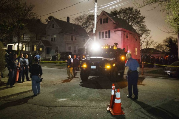 Law enforcement officials are seen in front of 67 Franklin St. after the capture of Dzhokhar Tsarnaev, the surviving suspect in the Boston Marathon bombings, in Watertown, Mass., on Friday, April 19, 2013. Tsarnaev was taken into custody Friday night.