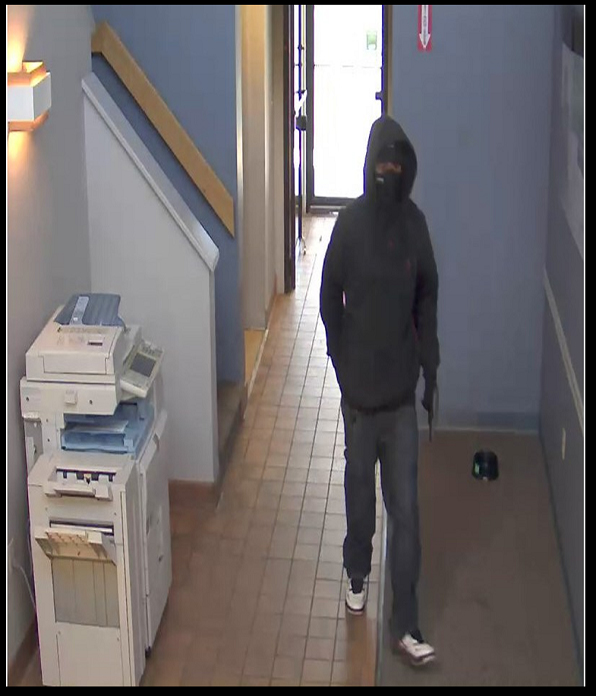 Police say a white male, approximately 6' tall, with a thin build, robbed a TB Bank branch on Market Street in South Portland on Monday.