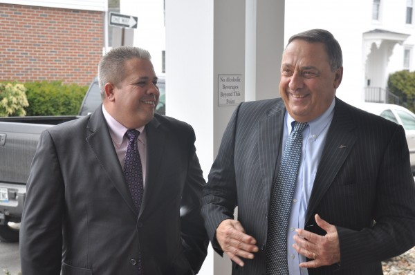 Steven Wallace (left), president of the Southern Midcoast Maine Chamber, greets Gov. Paul LePage as he arrives for a chamber luncheon at the Inn at Brunswick Station in Brunswick on April 10, 2013.