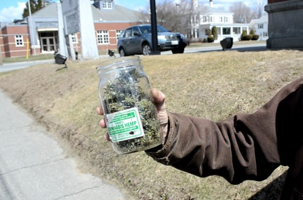 Donald Christen of Madison holds a jar of medical marijuana as he protests marijuana laws for the 23rd straight year outside Somerset County Superior Court in Skowhegan on Monday.