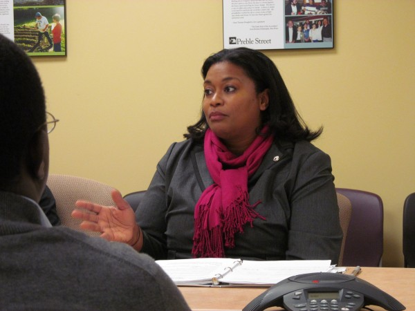 Latifa Lyles, acting director of the U.S. Department of Labor's Women's Bureau, discusses federal efforts to increase the minimum wage to $9 per hour during a roundtable forum at Florence House in Portland late Thursday afternoon.